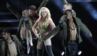 """FILE - In this June 13, 2017, file photo, U.S. singer Britney Spears performs during her concert in Taipei, Taiwan. Spears is taking her act on the road this summer with her """"Piece of Me"""" world tour, traveling across North America and Europe. The first show is July 12 in Washington. (AP Photo/Chiang Ying-ying, File)"""