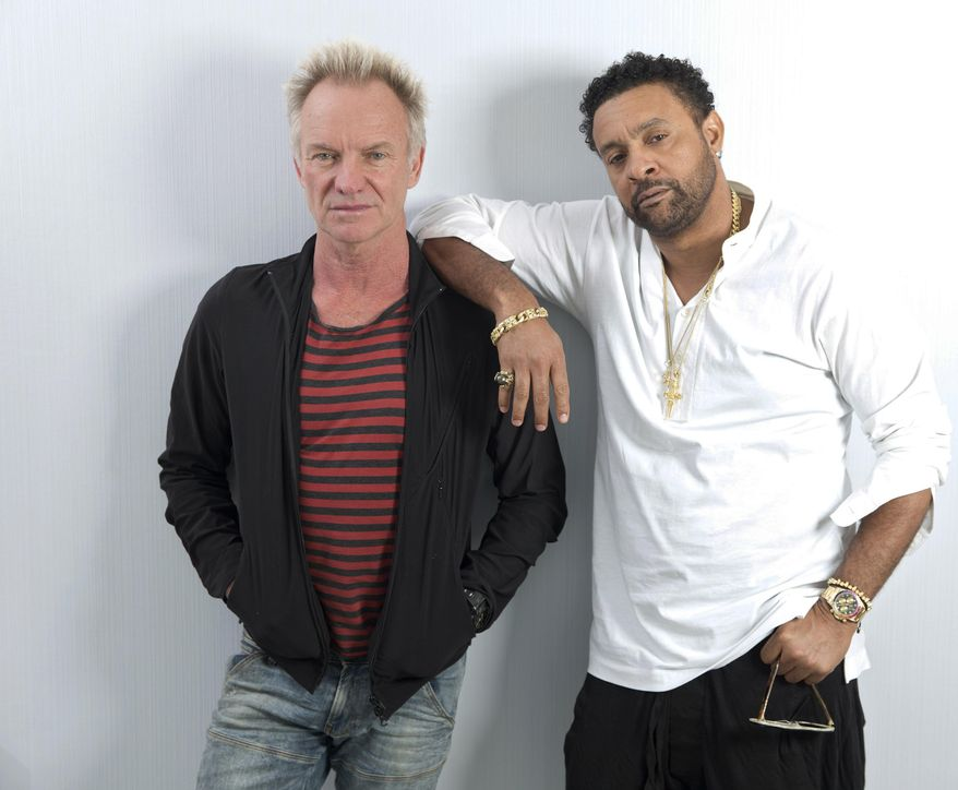 """In this April 23, 2018 photo, musicians Sting, left, and Shaggy pose at an interview to promote their new CD, """"44/876"""" at 520 West 28th by Zaha Hadid on in New York. (Photo by Brian Ach/Invision/AP)"""