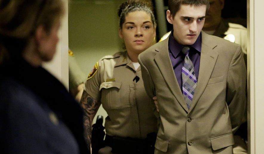 FILE - In this April 18, 2018 file photo, Michael Bever arrives at the Tulsa County Courthouse for his murder trial in Tulsa, Okla. A jury in Oklahoma found the younger of two brothers guilty late Wednesday night, May 9, 2018, of fatally stabbing their parents and three siblings. Jurors handed down the verdict during the fourth week of the trial of Michael Bever, 19, who was charged with five counts of first-degree murder and one count of assault and battery with intent to kill for his role in the July 2015 stabbings. (Mike Simons/Tulsa World via AP, File)