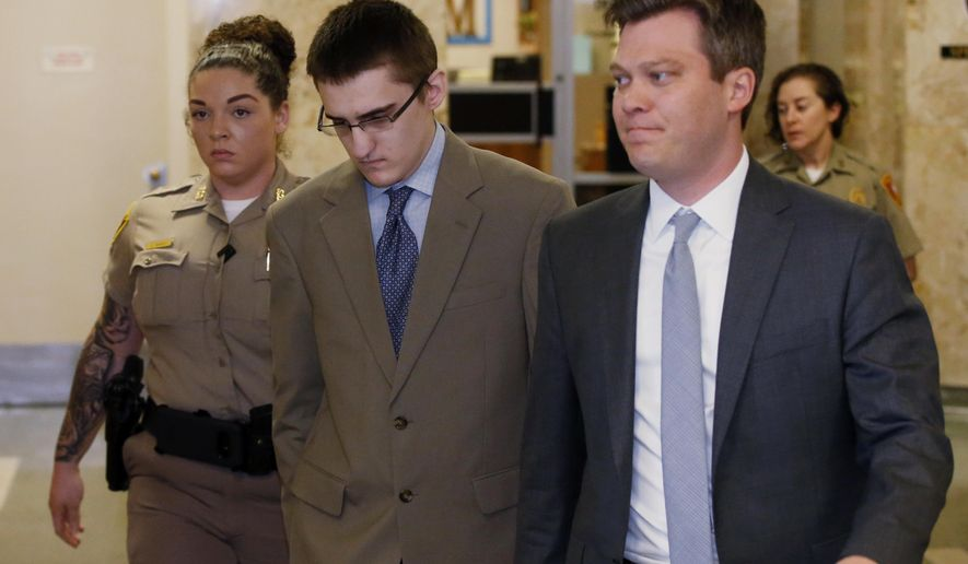 FILE - In this Tuesday, April 17, 2018 file photo, Michael Bever, center, is led from a courtroom following jury selection in his trial in Tulsa, Okla. At right is his defense attorney Corbin Brewster. Michael Bever, the younger of two brothers accused of fatally stabbing their parents and three siblings inside a suburban Oklahoma home, has been found guilty. Jurors handed down the verdict during the fourth week of the trial of Michael Bever, 19, who was charged with five counts of first-degree murder and one count of assault and battery with intent to kill for his role in the July 2015 stabbings. (AP Photo/Sue Ogrocki, File)