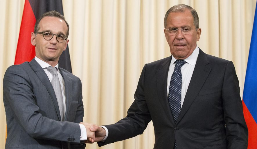 Russian Foreign Minister Sergey Lavrov, right, shakes hands with German Foreign Minister Heiko Maas after their joint news conference following the talks in Moscow, Russia, Thursday, May 10, 2018. (AP Photo/Alexander Zemlianichenko)