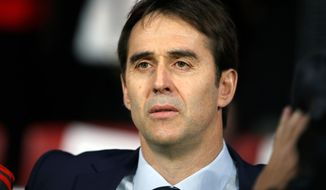 FILE - In this Tuesday, March 27, 2018 file photo, Spain's national soccer coach Julen Lopetegui listens to the national anthem during the international friendly soccer match between Spain and Argentina at the Wanda Metropolitano stadium in Madrid. Lopetegui has surpassed expectations after stepping into a tricky situation when he took as coach over the Spanish national team two years ago but he has made Spain a top contender again heading into the World Cup in Russia by giving the team a fresh identity and successfully mixing talented youngsters and fading veterans. (AP Photo/Paul White, File)