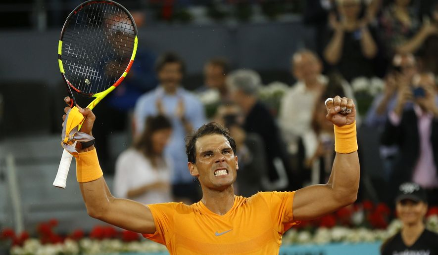 Rafael Nadal from Spain celebrates his victory over Diego Schwartzman from Argentina during a Madrid Open tennis tournament match in Madrid, Spain, Thursday, May 10, 2018. Nadal won 6-3, 6-4. (AP Photo/Francisco Seco)