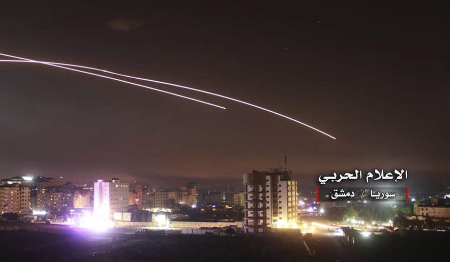 """This photo provided early Thursday, May 10, 2018, by the government-controlled Syrian Central Military Media, shows missiles rise into the sky as Israeli missiles hit air defense position and other military bases, in Damascus, Syria. The Israeli military on Thursday said it attacked """"dozens"""" of Iranian targets in neighboring Syria in response to an Iranian rocket barrage on Israeli positions in the Golan Heights, in the most serious military confrontation between the two bitter enemies to date. (Syrian Central Military Media, via AP)"""