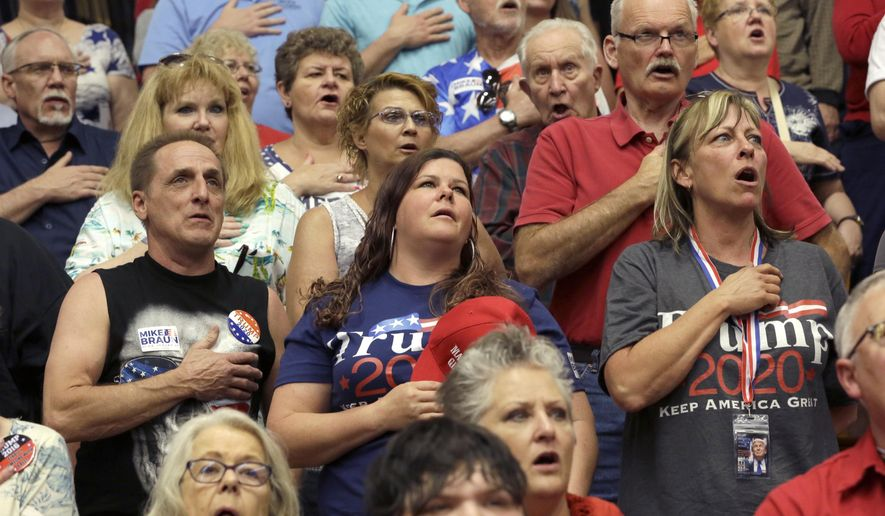 President Donald Trump supporters recite the Pledge of Allegiance before a campaign rally Thursday, May 10, 2018, in Elkhart, Ind. (AP Photo/Charles Rex Arbogast) ** FILE **