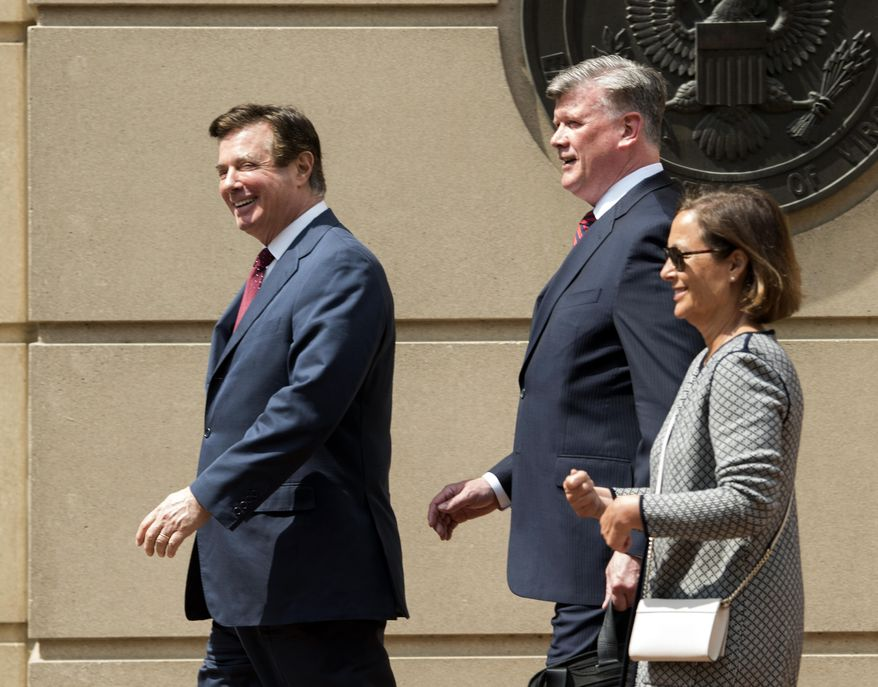"Paul Manafort, left, leaves the Alexandria Federal Courthouse with his attorney Kevin Downing, center, on Friday, May 4, 2018, in Alexandria, Va. A federal judge has asked skeptical questions about special counsel Robert Mueller's authority to bring charges against former Manafort and suggested prosecutors' true motive is getting Manafort to ""sing"" against the president. (AP Photo/Kevin Wolf)"