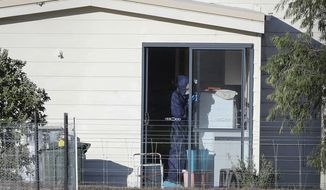 Police forensics investigate the death of seven people in a suspected murder-suicide in Osmington, east of Margaret River, south west of Perth, Australia Friday, May 11, 2018. Seven people including four children were found dead with gunshot wounds Friday at a rural property in southwest Australia in what could be the country's worst mass shooting in 22 years, police said. (Richard Wainwright/AAP Image via AP)