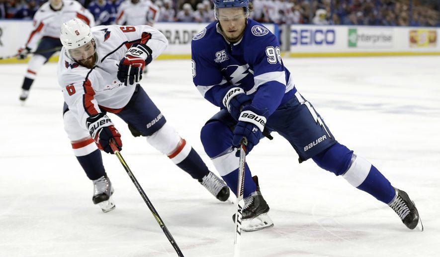 Tampa Bay Lightning defenseman Mikhail Sergachev (98) is stopped by Washington Capitals defenseman Michal Kempny (6) during the second period of Game 1 of an NHL Eastern Conference hockey playoff series Friday, May 11, 2018, in Tampa, Fla. (AP Photo/Chris O'Meara)