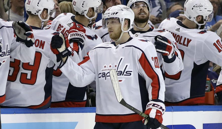 Washington Capitals center Lars Eller (20) celebrates with the bench after his goal against the Tampa Bay Lightning during the second period of Game 1 of an NHL Eastern Conference hockey playoff series Friday, May 11, 2018, in Tampa, Fla. (AP Photo/Chris O'Meara)