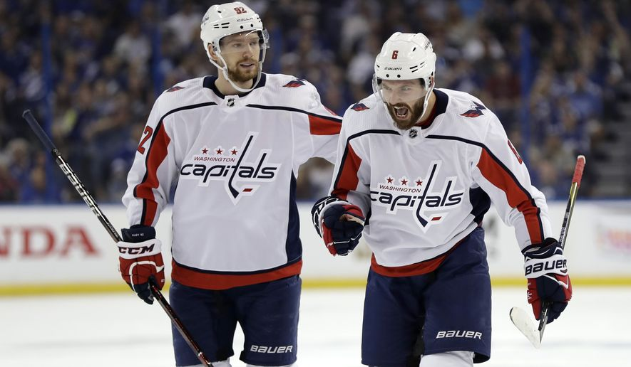 Washington Capitals defenseman Michal Kempny (6) celebrates with center Evgeny Kuznetsov (92) after Kempny scored against the Tampa Bay Lightning during the first period of Game 1 of an NHL Eastern Conference final hockey playoff series Friday, May 11, 2018, in Tampa, Fla. (AP Photo/Chris O'Meara)