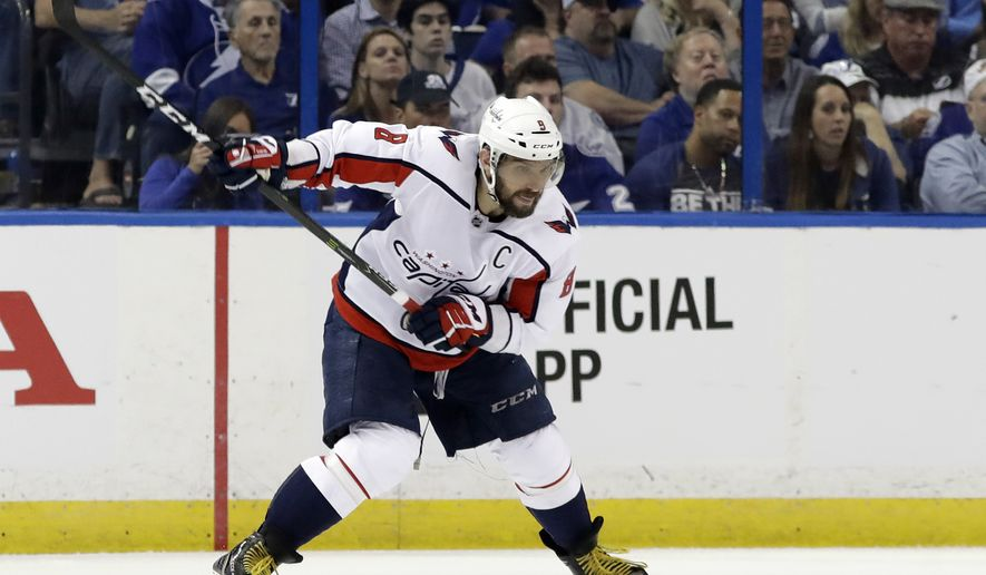 Washington Capitals left wing Alex Ovechkin (8) shoots against the Tampa Bay Lightning during the second period of Game 1 of the NHL Eastern Conference hockey playoff series Friday, May 11, 2018, in Tampa, Fla. (AP Photo/Chris O'Meara)