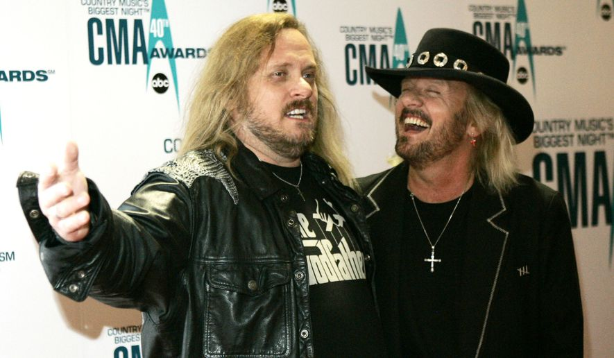 In this Nov. 6, 2006, file photo, Johnny Van Zant, left, arrives with his brother Donnie, at the 40th Annual CMA Awards in Nashville, Tenn. The house where rockers Ronnie, Donnie and Johnny Van Zant grew up is officially one of Florida's historic sites. (AP Photo/Chitose Suzuki, File)