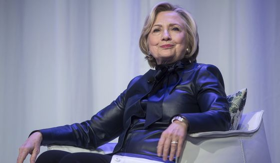 FILE - In this Wednesday, Dec. 13, 2017 file photo, Hillary Clinton sits on stage during a book tour event in Vancouver, British Columbia, Canada. On May 11, 2018, The Associated Press has found that stories circulating on the internet that Clinton is New Yorks new attorney general are untrue. (Darryl Dyck/The Canadian Press via AP)