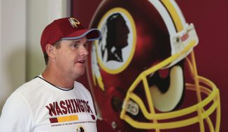 Redskins head coach Jay Gruden, walks to the podium at the start of a news conference at NFL football team's rookie minicamp at the Redskins Park in Ashburn, Va., Friday, May 11, 2018.(AP Photo/Manuel Balce Ceneta)