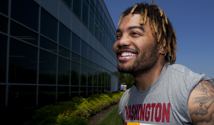 Washignton Redskin's second-round pick Derrius Guice, walks back to the locker room at the conclusion of the NFL football team's rookie minicamp at Redskins Park in Ashburn, Va., Friday, May 11, 2018. (AP Photo/Manuel Balce Ceneta)