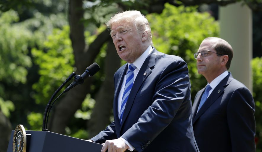 President Donald Trump speaks during an event about prescription drug prices with Health and Human Services Secretary Alex Azar, right, in the Rose Garden of the White House, Friday May 11, 2018, in Washington  (AP Photo/Evan Vucci)