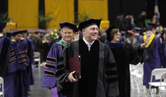 Rep. Steve Scalise, R-La., walks walk in the closing procession after delivering the commencement address at Louisiana State University commencement in Baton Rouge, La., Friday, May 11, 2018. Scalise was the most seriously injured in the June 2017 shooting during a Republican congressional baseball team practice. (AP Photo/Gerald Herbert)
