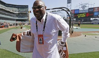 FILE -  In this April 3, 2018, file photo, former manager Dusty Baker shows off the lining of his sport coat before the start of an opening day baseball game between the San Francisco Giants and the Seattle Mariners in San Francisco. Baker lost his job with Washington after last season, when he guided the Nationals to a second straight NL East title. It has been a blessing of sorts. Baker never forgets to remind himself of his good fortune, even during the down times in his big league baseball career spanning a half-century. Sure, he still wants to manage and go out on his own terms when the time comes. (AP Photo/Eric Risberg, File)
