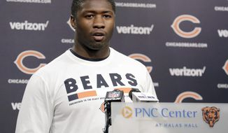 Chicago Bears linebacker Roquan Smith talks to reporters before the NFL football team's rookie minicamp Friday, May 11, 2018, in Lake Forest, Ill. (AP Photo/Nam Y. Huh)