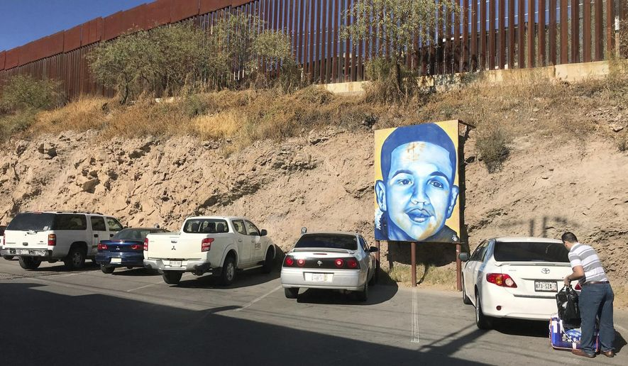 A portrait of 16-year-old Mexican youth Jose Antonio Elena Rodriguez, who was shot and killed in Nogales, Sonora, Mexico, is displayed on the Nogales street where he was killed that runs parallel with the U.S. border, Dec. 4, 2017. A U.S. Border Patrol agent who was acquitted of second-degree murder in a case that ended in mistrial will be retried on lesser charges, the attorney for the family of the rock-throwing teen killed in a 2012 cross-border shooting said Friday, May 11, 2018. Attorney Luis Parra, of Nogales, Arizona said he in was in the federal courtroom in Tucson when U.S. prosecutors announced they would retry agent Lonnie Swartz for manslaughter. He said the new trial was set for Oct. 23 and is expected to last two months. (AP Photo/Anita Snow) ** FILE **