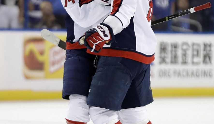 Washington Capitals left wing Alex Ovechkin (8) celebrates his goal against the Tampa Bay Lightning with defenseman John Carlson (74) during the first period of Game 1 of an NHL Eastern Conference final hockey playoff series Friday, May 11, 2018, in Tampa, Fla. (AP Photo/Chris O'Meara)