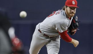 St. Louis Cardinals starting pitcher Miles Mikolas watches a throw to a San Diego Padres batter during the first inning of a baseball game Thursday, May 10, 2018, in San Diego. (AP Photo/Gregory Bull)