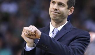 FILE- In this Wednesday, May 9, 2018 photo, Boston Celtics head coach Brad Stevens gestures during the first quarter of Game 5 of an NBA basketball playoff series in Boston. In just his fifth season Stevens has endeared himself to a championship-driven city after helping Boston make in improbable run back to the conference finals.  (AP Photo/Charles Krupa, File)