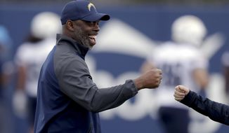 Los Angeles Chargers coach Anthony Lynn smiles during the team's NFL football rookie minicamp Friday, May 11, 2018, in Costa Mesa, Calif. (AP Photo/Chris Carlson)