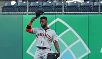 San Francisco Giants' Andrew McCutchen acknowledges fans as he takes right field for the first inning of a baseball game against the Pittsburgh Pirates in Pittsburgh, Friday, May 11, 2018. (AP Photo/Gene J. Puskar)