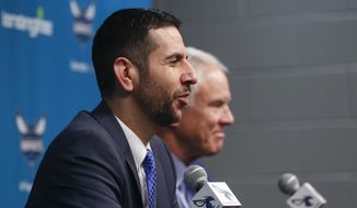 James Borrego speaks to the media, as Charlotte Hornets President of Basketball Operations and General Manager Mitch Kupchak listens, after Borrego was introduced as the new head coach of the Charlotte Hornets during an NBA basketball news conference in Charlotte, N.C., on Friday, May 11, 2018. (AP Photo/Nell Redmond)