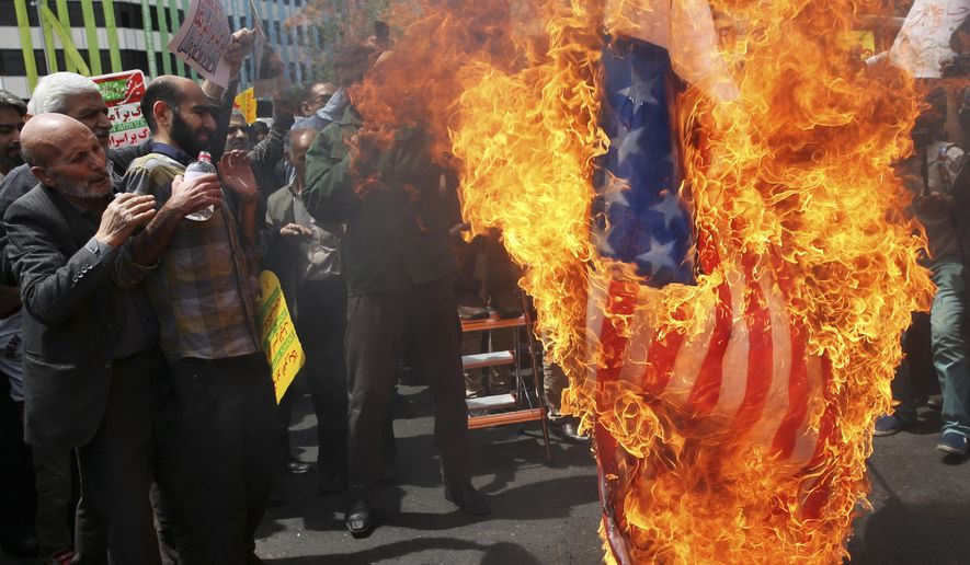 Iranian protestors burn a representation of a U.S. flag during a gathering after their Friday prayer in Tehran, Iran, Friday, May 11, 2018. Thousands of Iranians took to the streets in cities across the country to protest U.S. President Donald Trump's decision to pull out of the nuclear deal with world powers. (AP Photo/Vahid Salemi) **FILE**