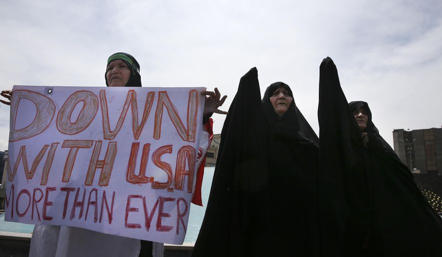 Iranian women attend an anti-U.S. gathering after the Friday prayer in Tehran, Iran, Friday, May 11, 2018. Thousands of Iranians took to the streets in cities across the country to protest U.S. President Donald Trump's decision to pull out of the nuclear deal with world powers. (AP Photo/Vahid Salemi)