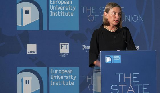 European Union foreign policy chief Federica Mogherini delivers her speech during the State of the Union conference organized by the European University Institute in Florence, Italy, Friday, May  11, 2018. (Claudio Giovannini/ANSA via AP)