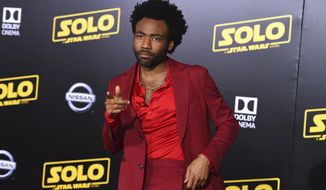 "Donald Glover arrives at the premiere of ""Solo: A Star Wars Story"" at El Capitan Theatre on Thursday, May 10, 2018, in Los Angeles. (Photo by Jordan Strauss/Invision/AP)"
