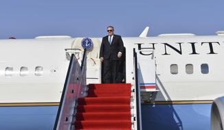 Secretary of State Mike Pompeo arrives at Pyonyang, North Korea airport on Wednesday, May 9, 2018. It began with quiet words from State Department officials: Apply for a new passport immediately. You may soon be going to a country for which ordinary U.S. passports are not valid for travel.  (AP Photo/Matthew Lee, Pool)