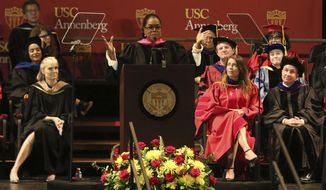 Oprah Winfrey, center, addresses USC Annenberg Class of 2018 at the Shrine Auditorium on Friday, May 11, 2018, in Los Angeles. (Photo by Willy Sanjuan/Invision/AP)