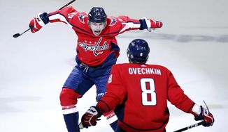 In this May 5, 2018, file photo, Washington Capitals left wing Jakub Vrana (13), from the Czech Republic, jumps into the arms of left wing Alex Ovechkin (8), from Russia, after scoring the go-ahead goal during the third period of Game 5 in the second round of the NHL Stanley Cup hockey playoffs against the Pittsburgh Penguins, in Washington. The Capitals have never used more rookies during a single postseason than the half-dozen who helped Alex Ovechkin and Co. reach the Eastern Conference final against the Tampa Bay Lightning. Rookie Vrana delivered an assist on tying the score before putting the go-ahead goal in the net. (AP Photo/Alex Brandon, File)