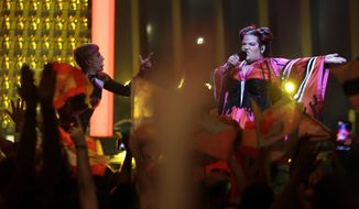 Netta from Israel performs the song 'Toy' in Lisbon, Portugal, Tuesday, May 8, 2018 during the first semi-final for the Eurovision Song Contest. The Eurovision Song Contest semi-finals take place in Lisbon on Tuesday, May 8 and Thursday, May 10 with the the grand final taking place on Saturday May 12, 2018. (AP Photo/Armando Franca)