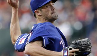 Texas Rangers starting pitcher Cole Hamels throws to a Houston Astros batter during the first inning of a baseball game Friday, May 11, 2018, in Houston. (AP Photo/Michael Wyke)