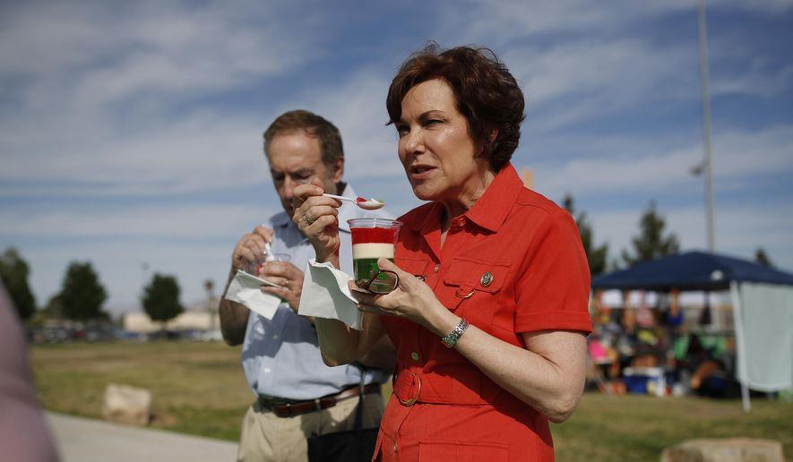 In this May 5, 2018, photo, Rep. Jacky Rosen, D-Nev., samples food from a vendor at a Cinco de Mayo festival in North Las Vegas, Nev. (AP Photo/John Locher)