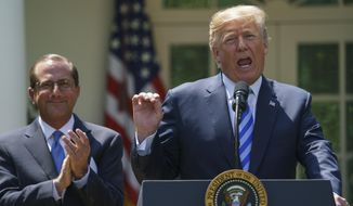 President Donald Trump speaks during an event about prescription drug prices with Health and Human Services Secretary Alex Azar, left, in the Rose Garden of the White House in Washington, Friday, May 11, 2018. (AP Photo/Carolyn Kaster)