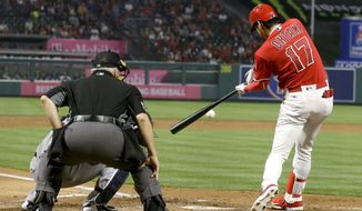 Los Angeles Angels' Shohei Ohtani, of Japan, hits an RBI-double against the Minnesota Twins during the third inning of a baseball game in Anaheim, Calif., Thursday, May 10, 2018. (AP Photo/Chris Carlson)