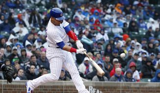 Chicago Cubs' Willson Contreras hits a grand slam during the first inning of a baseball game against the Chicago White Sox in Chicago, Friday, May 11, 2018. (AP Photo/Jeff Haynes)