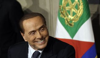In this picture taken April 12, 2018, Forza Italia (Go Italy) party leader Silvio Berlusconi meets journalists at the Quirinale presidential palace after talks with Italian President Sergio Mattarella, in Rome, Thursday, April 12, 2018. A court in Milan has ruled that Berlusconi can run for office again, five years after a tax fraud conviction. The Milan daily Corriere della Sera on Saturday, May 12, 2018, reported that the tribunal had decided favorably a day earlier on a request from lawyers for the 81-year-old former premier. (AP Photo/Gregorio Borgia)