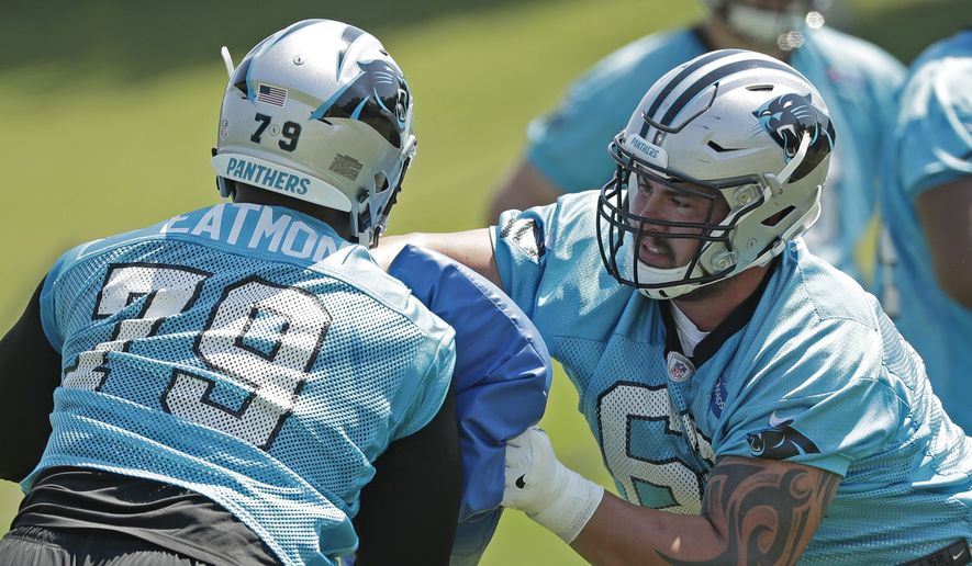 Carolina Panthers' Taylor Hearn (62) runs a drill against Quinterrius Eatmon (79) during the NFL football team's rookie camp in Charlotte, N.C., Saturday, May 12, 2018. (AP Photo/Chuck Burton)