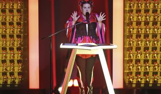 Netta from Israel performs the song 'Toy' in Lisbon, Portugal, Friday, May 11, 2018 during a dress rehearsal for the Eurovision Song Contest. The Eurovision Song Contest grand final takes place in Lisbon on Saturday May 12, 2018. (AP Photo/Armando Franca)