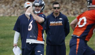 Denver Broncos quarterback Chad Kelly, back, throws a pass to tight end Jake Butt during an orientation session for the team's rookies Saturday, May 12, 2018, at the Broncos' headquarters in Englewood, Colo. (AP Photo/David Zalubowski)