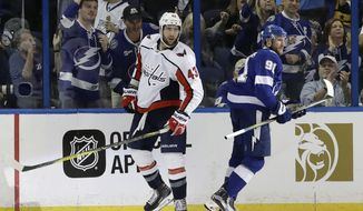 Tampa Bay Lightning center Steven Stamkos (91) celebrates in front of Washington Capitals right wing Tom Wilson (43) after scoring during the third period of Game 1 of the NHL Eastern Conference finals hockey playoff series Friday, May 11, 2018, in Tampa, Fla. (AP Photo/Chris O'Meara)