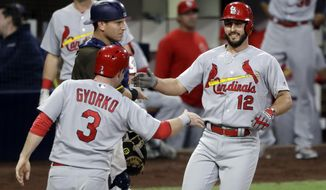 St. Louis Cardinals' Paul DeJong, right, celebrates with teammate Jedd Gyorko (3) after hitting a three-run home run during the second inning of a baseball game against the San Diego Padres, Friday, May 11, 2018, in San Diego. (AP Photo/Gregory Bull)