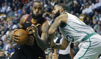 FILE - In this Feb. 11, 2018, file photo, Cleveland Cavaliers' LeBron James (23) drives against Boston Celtics' Marcus Morris (13) during the third quarter of an NBA basketball game in Boston. They both took winding paths to get here, but the Cleveland Cavaliers and Boston Celtics are back in the Eastern Conference finals for the second straight season. LeBron James is looking to join an elite list of players to appear in eight consecutive NBA finals. (AP Photo/Michael Dwyer, File)